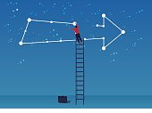 The businessman connects the stars into arrows