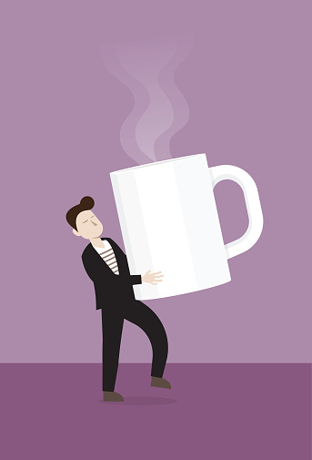 The businessman holds a big coffee cup