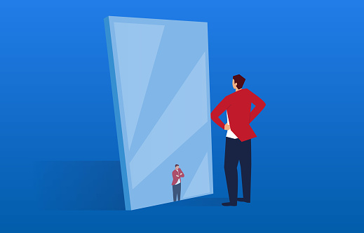The businessman in the mirror has become small