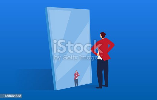 istock The businessman in the mirror has become small 1135064348