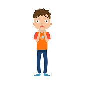 The cute brown-haired boy standing in blue pants with a scared face. Vector illustration in flat cartoon style.