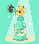 istock The cute bulldog holds a megaphone and gives a presentation about the COVID-19 Vaccine 1323781636