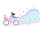 The cute girl goes by bicycle with a dog in a basket down the street. At a background flowers. Hand drawn fashionable design on spring season ride. Ideal for scrap booking, post cards and wall decoration