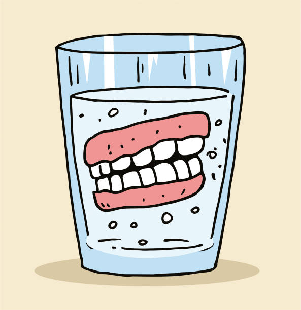 The denture in the glass vector art illustration