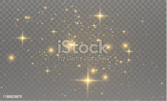 The yellow dust sparks and golden stars shine with special light. Vector sparkles on a transparent background.  Sparkling magical dust particles.