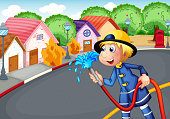 The fireman holding hose rescuing a village on fire