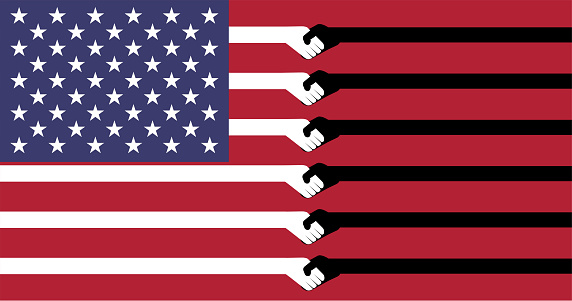 The flag of the United States of America has a white and black stripe showing the handshake symbol for reconciliation / hope for racism in America will change for the better.