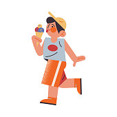 The funny young boy in orange shorts eating ice cream. Vector illustration in the flat cartoon style.