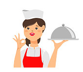 The girl chef holds a tray for hot dishes and with an Ok sign on her hand. Vector illustration on white background.