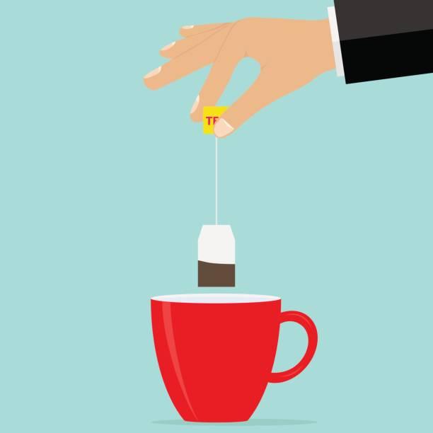 ilustrações de stock, clip art, desenhos animados e ícones de the hand holds a teabag over the cup. brew tea - chá bebida quente