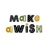 istock The inscription: Make a wish, in Scandinavian style.  It can be used for card, mug, brochures, poster, t-shirts etc. 1343779897