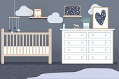 The interior of the children's bedroom in gray tones and light furniture. Baby bed with pendant toys. Abstract paintings on the walls