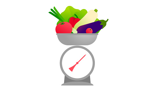 The kitchen scales with vegetables.