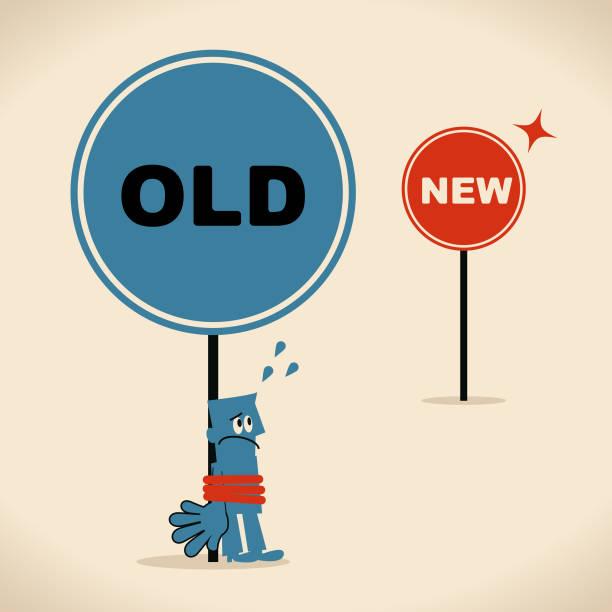 die neue und die alte weise, geschäftsmann ist mit der alten schilder, konzept über bürokratie oder alte gewohnheit, sucht gefesselt, alte dachte muster - feststecken stock-grafiken, -clipart, -cartoons und -symbole
