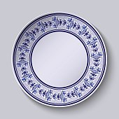 The ornamented decorative plate. Template design in ethnic style Gzhel porcelain painting with flowers and birds.
