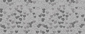 The pattern of black and white hearts. Horizontally and vertically seamless background. Isolated.