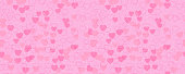The pattern of red and pink hearts. Horizontally and vertically seamless background. Isolated.