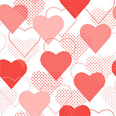 The seamless pattern with red and pink polka dot hearts. Vector.