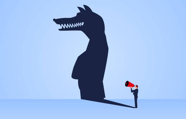 illustrazioni stock, clip art, cartoni animati e icone di tendenza di the shadow of a businessman holding a megaphone standing and shouting is a wolf - malvagità