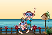 istock The small and big monkey at  bridge 185926540