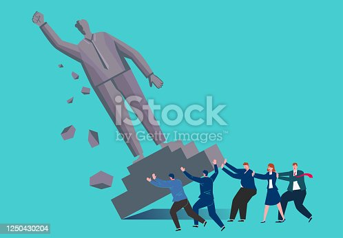 istock The statue of the giant was pushed to it by a group of businessmen 1250430204
