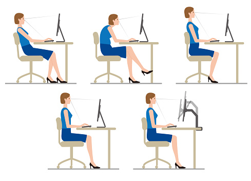 The woman sits down and works at the computer. posture.