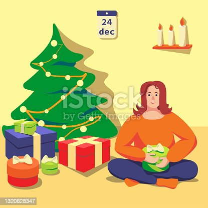 istock The women is sitting on floor near christmas tree with gifts 1320628347