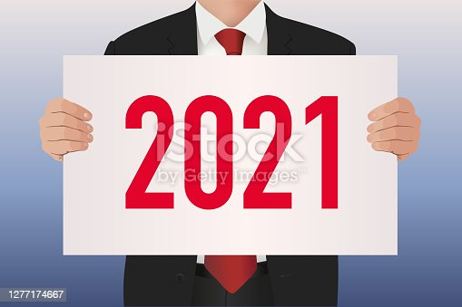 istock The year 2021 inscribed on a white sign held by a man in a suit. 1277174667