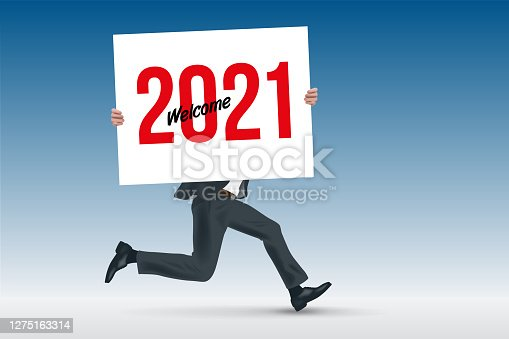 istock The year 2021 inscribed on a white sign held by a man running in a suit. 1275163314