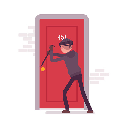 Thief breaking the door with a crowbar