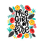 This girl is on fire. Handdrawn illustration. Positive quote made in vector.Motivational slogan. Inscription for t shirts, posters, cards. Floral digital sketch style design. Flowers around.