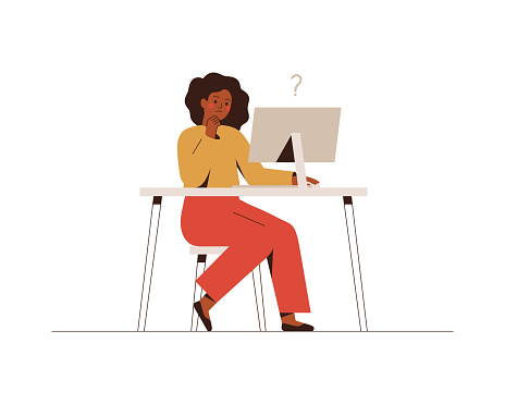 Thoughtful African businesswoman works at the computer and thinks or solves the problem. clipart