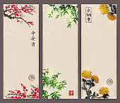 Three banners with blossoming sakura, bamboo and chrysanthemum. Traditional oriental