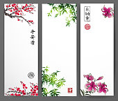 Three banners with sakura in blossom, bamboo and lily. Traditional
