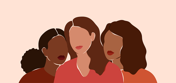 Three beautiful women with different skin colors together. African, latin and caucasian girls stand side by side. Sisterhood and females friendship.