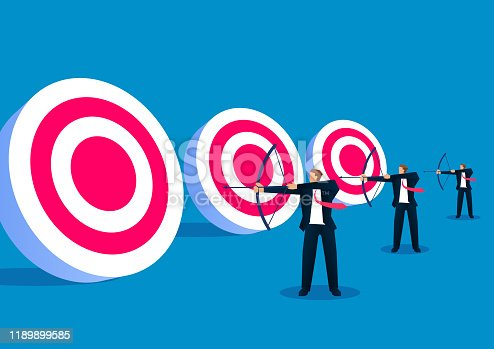 istock Three businessmen holding bows and standing in a row ready to shoot bullseye 1189899585