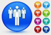 Three Businessmen Standing Icon on Shiny Color Circle Buttons. The icon is positioned on a large blue round button. The button is shiny and has a slight glow and shadow. There are 8 alternate color smaller buttons on the right side of the image. These buttons feature the same vector icon as the large button. The colors include orange, red, purple, maroon, green, and indigo variations.