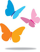Vector illustration of three pretty butterflies with a shadow beneath them.