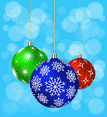 Three Christmas Balls with different patterns on blue .background. Vector illustration.