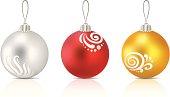 Three christmas glass balls on white background.