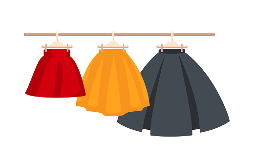 three colored skirts on hangers.