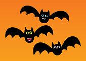 Vector illustration of three cute bats on an orange background.
