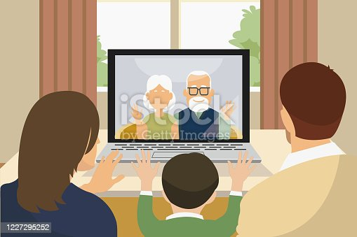 multi genreational asian family talking using video call