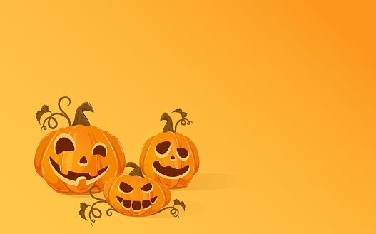 Three Halloween Pumpkins on Orange Background