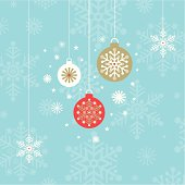 Three hanging christmas baubles on a blue snowflake background.