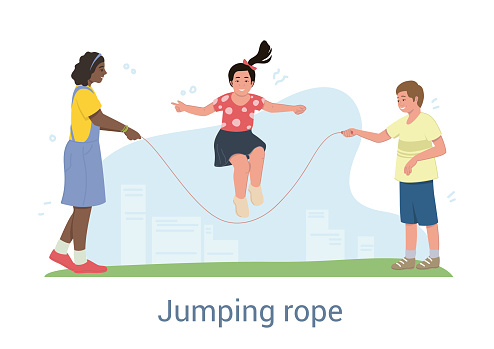 Three happy young children playing with a skipping rope