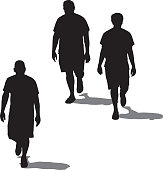 Vector silhouettes of three men walking together with their shadows.