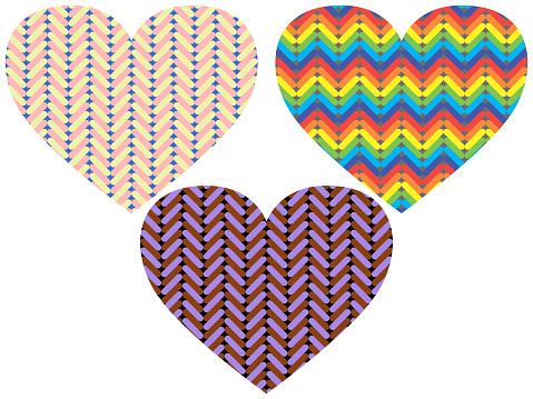 three multicolored knitted hearts