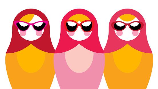 Three nesting dolls with glasses