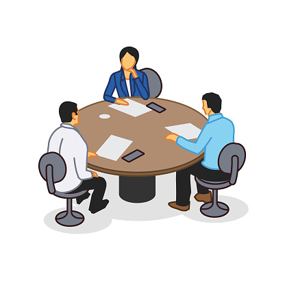 Three people at a round table office meeting